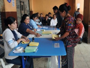 """An indigenous woman prepares to cast her vote during presidential elections, in San Juan Sacatepequez 32 km west of Guatemala City, on September 11, 2011. Polls opened as Guatemalans elect a new president from among 10 contenders, with a former army general who served during the country's """"dirty war"""" in the 1980s heavily tipped to win. Pre-election surveys showed ex-general Otto Perez Molina from the Patriotic Party some 20 points ahead of his nearest rival, but he is unlikely to win the 50 percent-plus-one necessary to avoid a run-off vote in November.  AFP PHOTO/Rodrigo ARANGUA"""