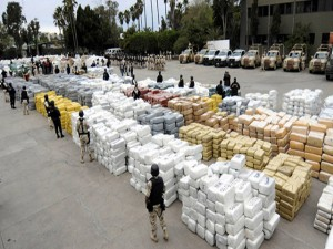 Members of the Mexican Federal Police guard over 105 tonnes of marijuana on October 18, 2010 in the border town of Tijuana, Mexico, seized after a clash with drug traffickers in the largest such seizure in recent years, the military said. Over 10,000 packages of marijuana were seized, weighing in at some 105 tonnes. Eleven people were arrested in the operation.  AFP PHOTO / FRANCISCO VEGA