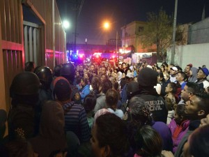 Relatives of inmates gather outside the Topo Chico prison in the northern city of Monterrey in Mexico where according to local media at least 30 people died in a prison riot on February 11, 2016. Riot police and ambulances were deployed at the Topo Chico prison as smoke billowed from the facility. Broadcaster Televisa reported that 30 died while Milenio television spoke of 50 victims, with inmates and prison guards among them.   AFP PHOTO / JULIO CESAR AGUILAR