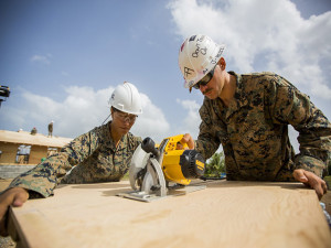 U.S. Marine Corps Lance Cpl. Kendra Hazelwood, left, a combat engineer with Special Purpose Marine Air-Ground Task Force-Southern Command and Pfc. Jared Colvin, a combat engineer with SPMAGTF-SC, saw wood for Jardin de Niños: El Porvenir, a reconstructed school, in Puerto Lempira, Honduras, July 28, 2015. SPMAGTF-SC is a temporary deployment of Marines and Sailors throughout Honduras, El Salvador, Guatemala, and Belize with a focus on building and maintaining partnership capacity with each country through shared values, challenges, and responsibility. (U.S. Marine Corps Photo by Cpl. Katelyn Hunter/Released).