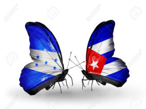 Two butterflies with flags on wings as symbol of relations Honduras and Cuba